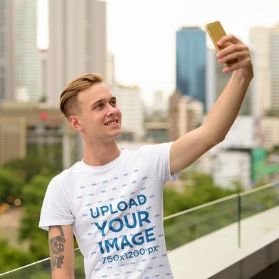 Basic T-Shirt Mockup of a Young Man Taking a Selfie 44415-r-el2
