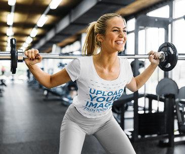 T-Shirt Mockup Featuring a Woman Lifting Weight at a Gym 40632-r-el2