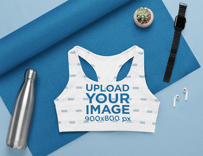 Flat Lay Mockup of a Sublimated Sports Bra in a Yoga Setting m1201