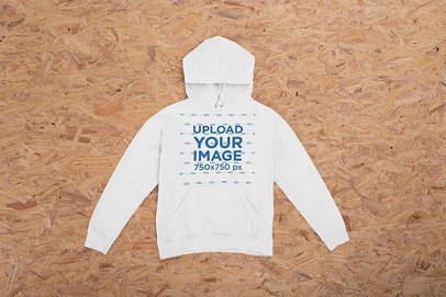 Mockup of a Hoodie Laid Flat on a Wooden Surface m1227