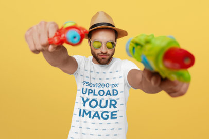 T-Shirt Mockup of a Man Holding Two Water Pistols 37652-r-el2