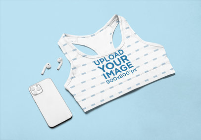 Mockup of a Sports Bra Placed Next to a Phone m1196