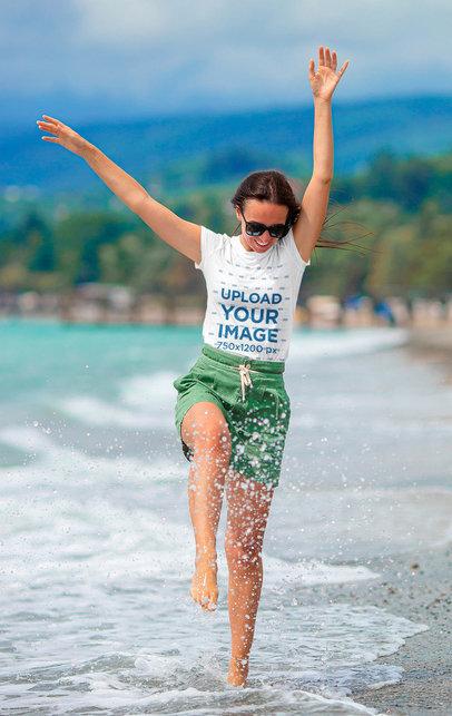 T-Shirt Mockup of a Woman Having Fun at the Beach 44471-r-el2