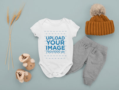 Onesie Mockup Featuring a Baby Boy's Outfit Placed on a Plain Background m1134