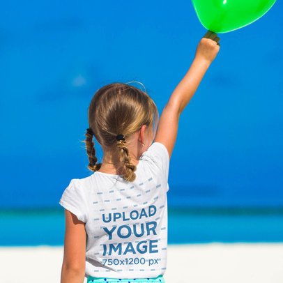 Back-View T-Shirt Mockup of a Girl Holding a Balloon at the Beach 35352-r-el2