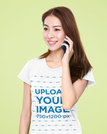 T-Shirt Mockup of a Happy Woman Talking on Her Phone in a Studio 46760-r-el2
