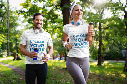 T-Shirt Mockup Featuring a Smiling Couple Running Outdoors 40703-r-el2
