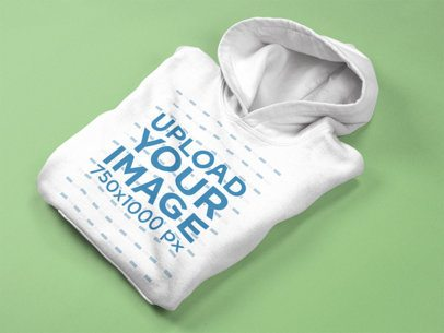 Pullover Hoodie Mockup Lying Folded on a Solid Surface a15244