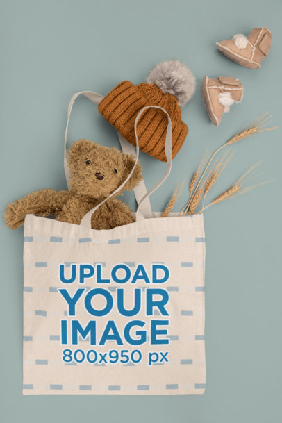 Tote Bag Mockup Featuring a Teddy Bear and Baby Garments m1137