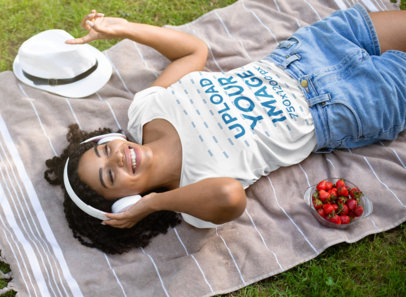 T-Shirt Mockup Featuring a Young Woman Lying on a Blanket in the Garden 45726-r-el2