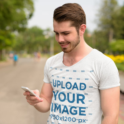 T-Shirt Mockup of a Man Checking His Phone on the Street 44412-r-el2