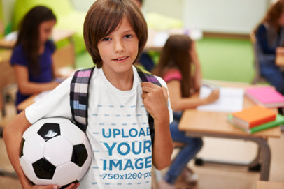 T-Shirt Mockup Featuring a Boy Carrying a Soccer Ball at School 38245-r-el2