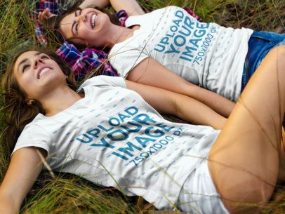 Two Girls Wearing Different Tshirts Mockup While Lying on the Grass a15318