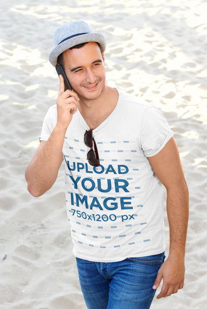 T-Shirt Mockup Featuring a Man on the Phone at the Beach 45142-r-el2