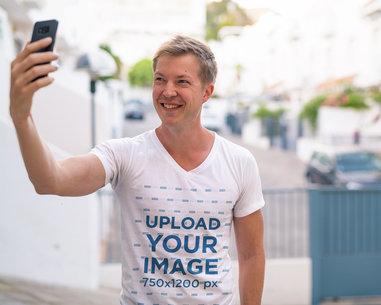 V-Neck T-Shirt Mockup of a Happy Man Taking a Selfie 41229-r-el2