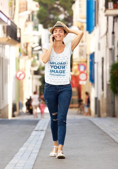 T-Shirt Mockup Featuring a Joyful Woman Walking Through a City 45188-r-el2