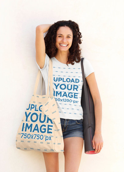 T-Shirt Mockup of a Happy Curly-Haired Woman Carrying a Tote Bag 38327-r-el2