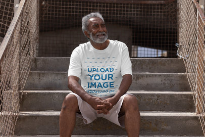 T-Shirt Mockup of a Senior Man Sitting on a Staircase 41911-r-el2