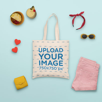 Mockup of a Tote Bag Surrounded by Summer Accessories and a Tropical Drink m1662