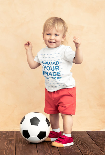 T-Shirt Mockup of a Toddler Standing by a Soccer Ball 43080-r-el2