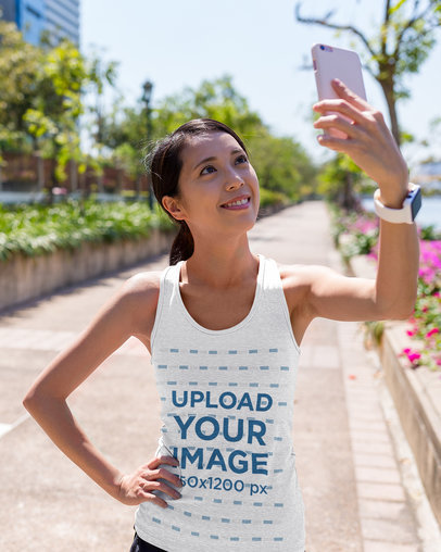 Tank Top Mockup of a Female Runner Taking a Selfie 44835-r-el2