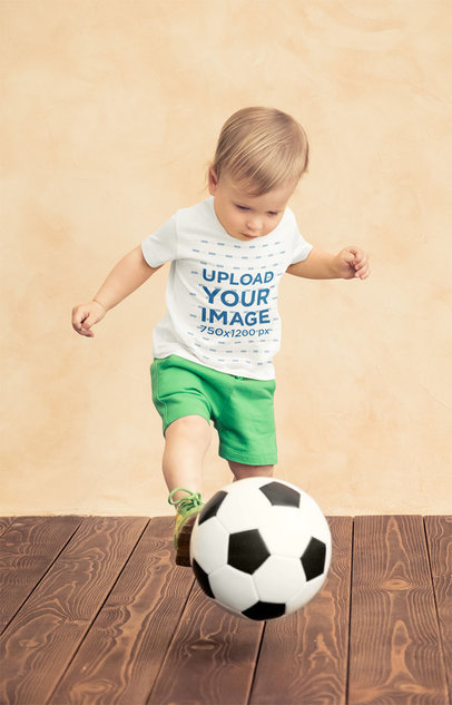 Mockup of a Little Boy Wearing a T-Shirt and Playing With a Soccer Ball 43082-r-el2