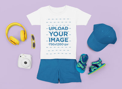 T-Shirt Mockup of a Boy's Outfit Laid Flat on a Customizable Surface m1261