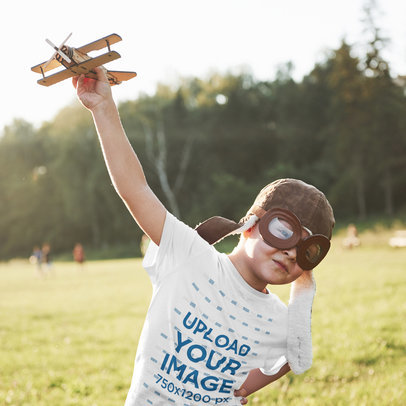 T-Shirt Mockup Featuring a Boy With Aviator Goggles Playing With a Plane Toy 46206-r-el2