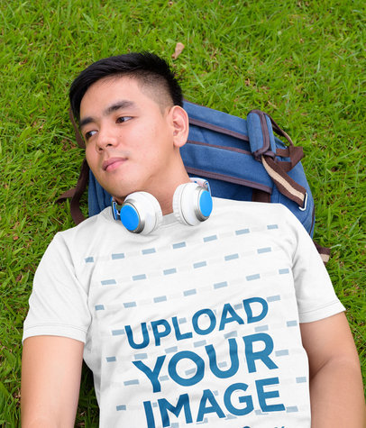T-Shirt Mockup of a Young Man Lying on the Grass 44390-r-el2