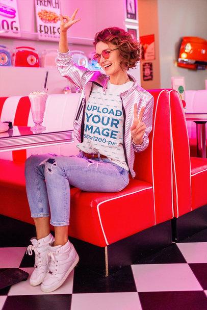 Round-Neck Tee Mockup Featuring a Woman Inside a Retro Restaurant m2126-r-el2