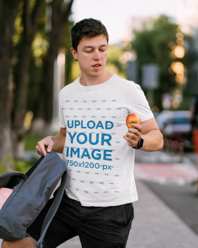 T-Shirt Mockup of a College Student Eating an Apple m1343-r-el2