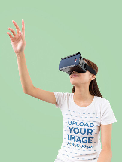 Studio Mockup of a Woman in a T-Shirt Using a VR Device M1815-r-el2