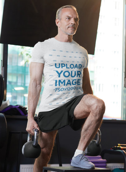 T-Shirt Mockup of a Middle-Aged Man Working Out at the Gym M1447-r-el2