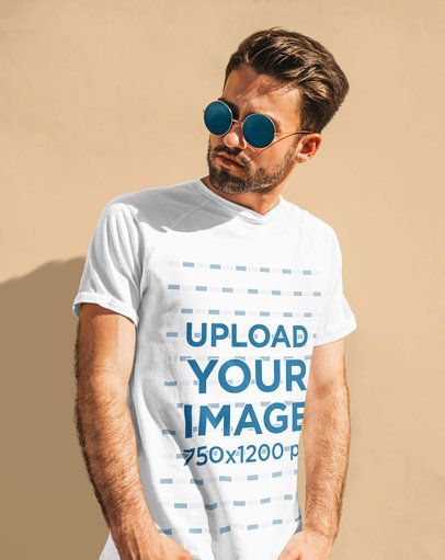 T-Shirt Mockup Featuring a Man with Sunglasses Posing Against a Wall M1613-r-el2