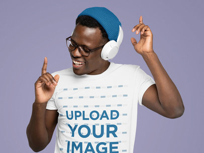 T-Shirt Mockup Featuring a Man with Glasses Listening to Music m1793-r-el2