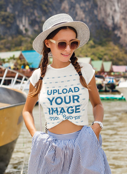Mockup of a Stylish Woman Wearing a Knotted T-Shirt While Traveling m1864-r-el2