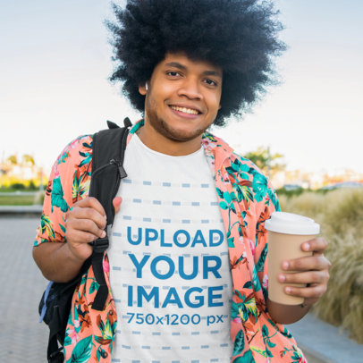 T-Shirt Mockup Featuring a Man with Natural Hair Holding a Drink M2182-r-el2