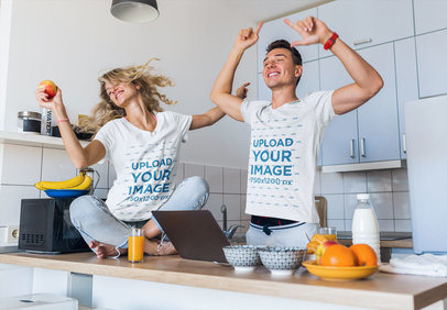 T-Shirt Mockup of a Fun Couple Dancing in Their Kitchen m2175-r-el2
