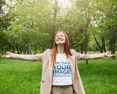 Tee Mockup of a Joyful Woman with Arms Wide Open at the Woods M2125-r-el2