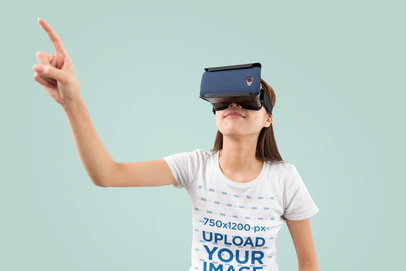 T-Shirt Mockup of a Woman Playing a VR Game in a Studio m1814-r-el2