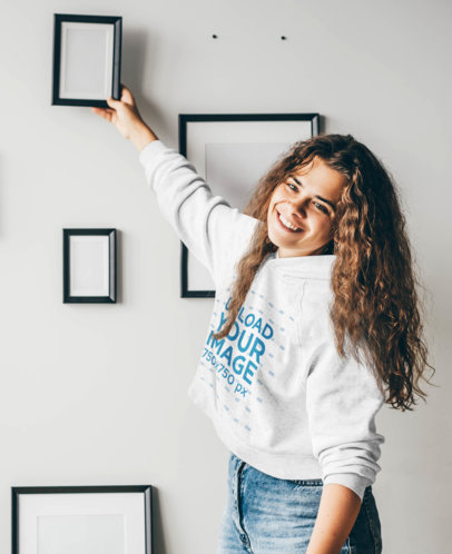 Hoodie Mockup of a Curly-Haired Woman Decorating a Wall m1918-r-el2