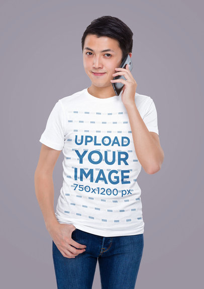T-Shirt Mockup of a Man Posing in a Studio While Talking on the Phone m1752-r-el2