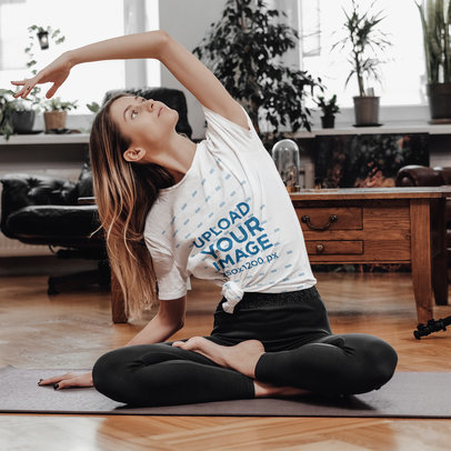 Mockup of a Young Woman Practicing Yoga In Her Living Room with a Knotted Tee m2381-r-el2