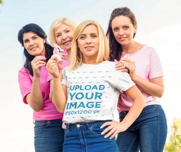 T-Shirt Mockup of a Woman Holding a Pink Ribbon m2525-r-el2