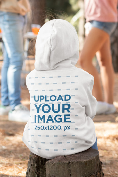 Hoodie Mockup of a Little Girl Sitting on a Log at a 4th of July Party 33041a