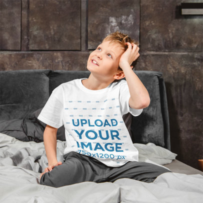 Basic T-Shirt Mockup of a Kid Sitting on a Bed m2526-r-el2