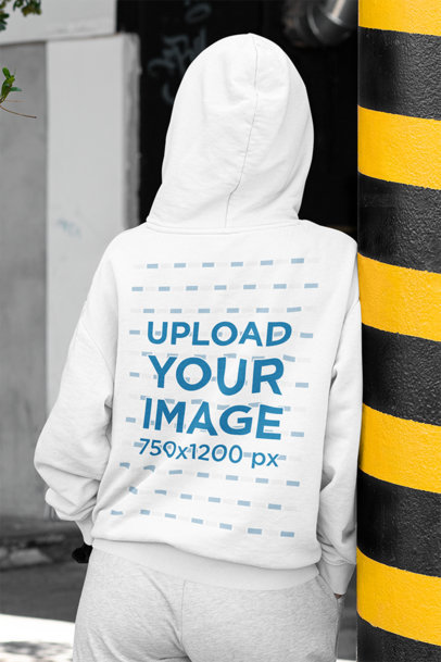 Mockup of the Back of a Woman Wearing a Hoodie in the Street m421