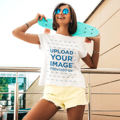 T-Shirt Mockup of a Young Woman Holding a Penny Board Over Her Shoulders m2499-r-el2