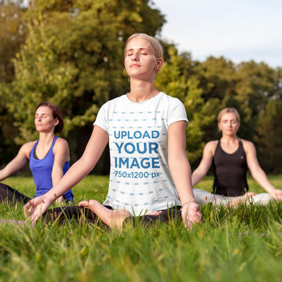 T-Shirt Mockup of a Woman Meditating at an Outdoor Yoga Session m1564-r-el2