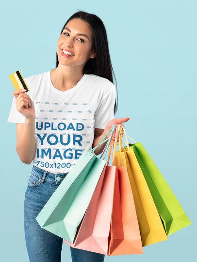 T-Shirt Mockup of a Joyful Woman Holding a Credit Card and Shopping Bags 44614-r-el2